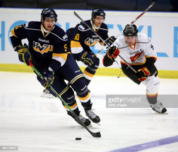Mikko Luoooma of HV71 Jonkoping fight for the puck with Simon Gamache of Bern during the IIHF Champions Hockey League match between HV71 Joenkoeping...