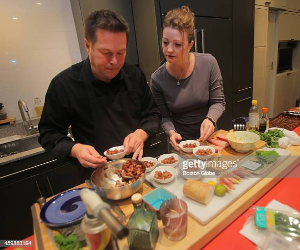 Mikko Nissinen and Shannon Parsley work together on an appetizer Nissinen prepares a Japanese meal for guests including Rie Ichikawa Peter Freedberg...