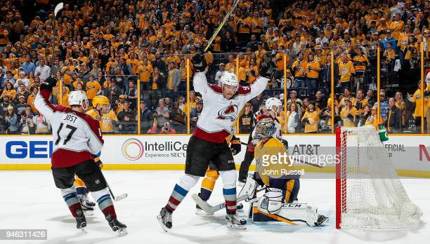 Mikko Rantanen and Tyson Jost of the Colorado Avalanche celebrate a late goal against Pekka Rinne of the Nashville Predators in Game Two of the...