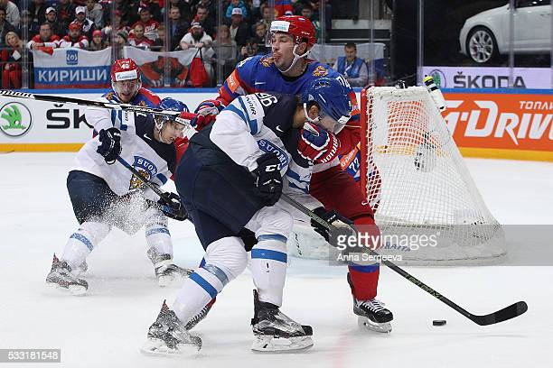Mikko Rantanen of Finland and Alexei Yemelin of Russia battle for the puck at Ice Palace on May 21 2016 in Moscow Russia
