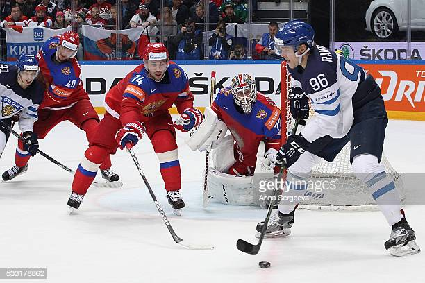 Mikko Rantanen of Finland plays the puck against Alexei Yemelin of Russia at Ice Palace on May 21 2016 in Moscow Russia