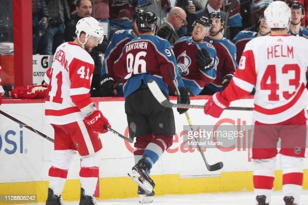 Mikko Rantanen of of the Colorado Avalanche celebrates a goal against the Detroit Red Wings with his bench at the Pepsi Center on March 5 2019 in...
