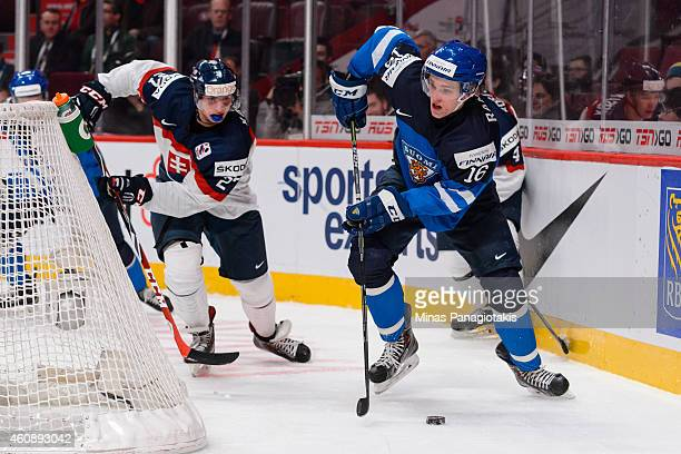Mikko Rantanen of Team Finland plays the puck behind the net during the 2015 IIHF World Junior Hockey Championship game against Team Slovakia at the...