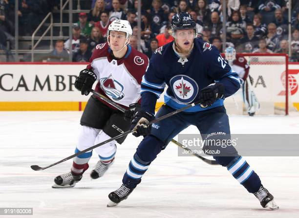 Mikko Rantanen of the Colorado Avalanche and Patrik Laine of the Winnipeg Jets follow the play down the ice during first period action at the Bell...