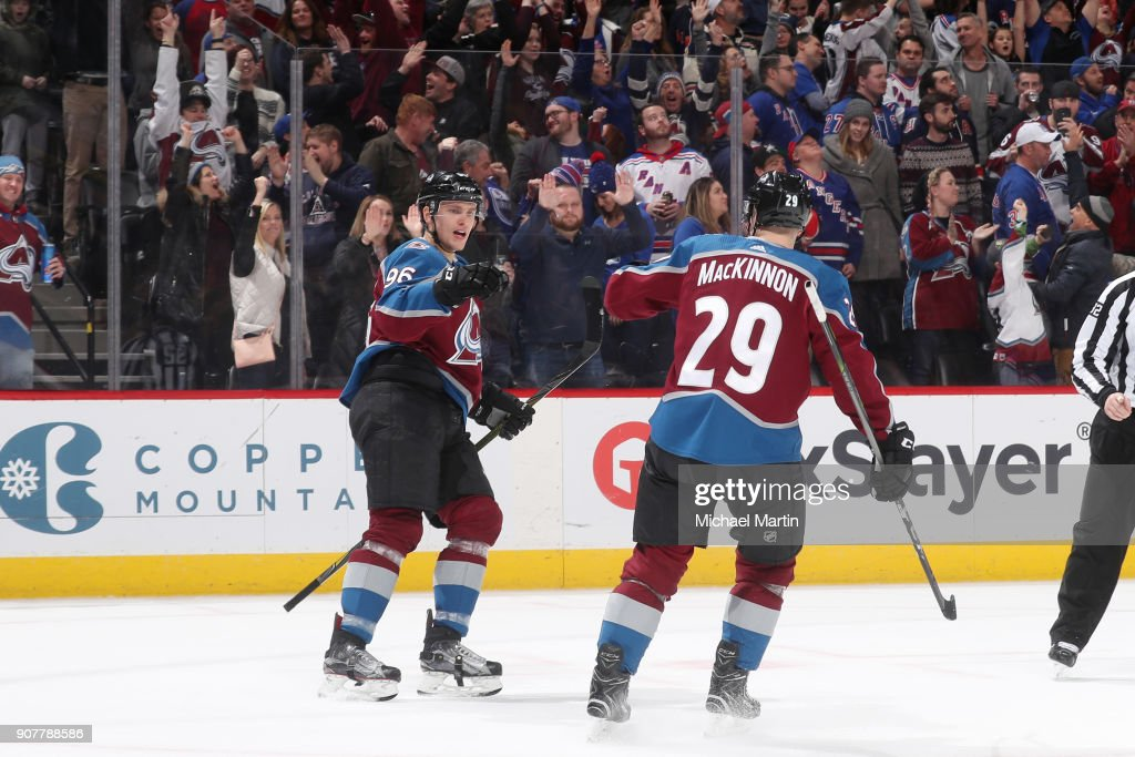 Mikko Rantanen #96 of the Colorado Avalanche celebrates a goal against the New York Rangers with teammate Nathan MacKinnon #29 at the Pepsi Center on January 20, 2018 in Denver, Colorado. The Avalanche defeated the Rangers 3-1.