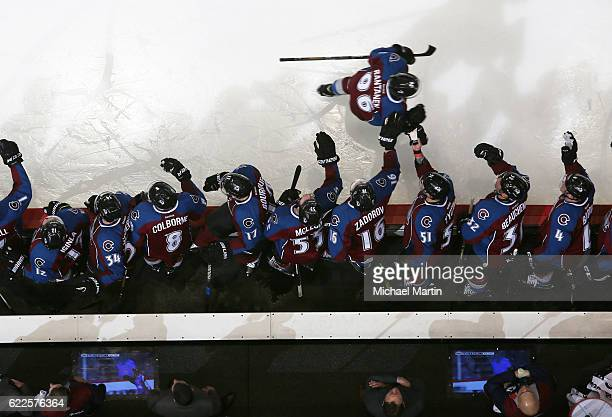 Mikko Rantanen of the Colorado Avalanche celebrates his first career NHL goal with his bench during the game against the Winnipeg Jets at the Pepsi...