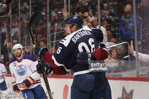 Mikko Rantanen of the Colorado Avalanche celebrates with Nathan MacKinnon after scoring a goal against the Edmonton Oilers at the Pepsi Center on...
