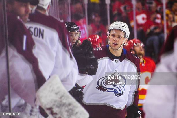 Mikko Rantanen of the Colorado Avalanche celebrates with the bench after scoring his team's second goal against the Calgary Flames in Game Five of...