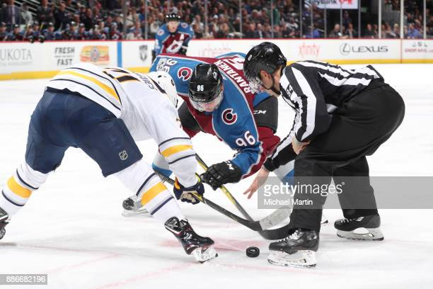 Mikko Rantanen of the Colorado Avalanche faces off against Evan Rodrigues of the Buffalo Sabres at the Pepsi Center on December 5 2017 in Denver...