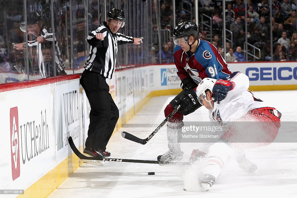 Mikko Rantanen #96 of the Colorado Avalanche fights for control of the puck against Markus Hannikainen#33 of the Columbus Blue Jackets at the Pepsi Center on December 1, 2016 in Denver, Colorado.