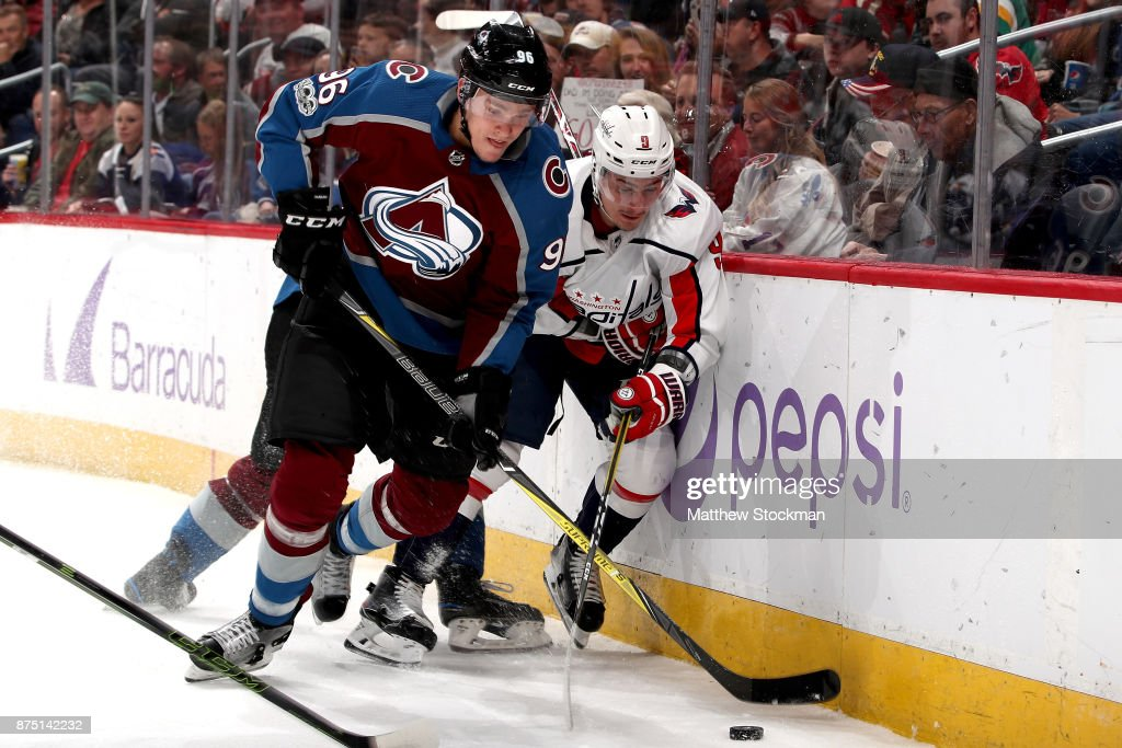 Mikko Rantanen #96 of the Colorado Avalanche fights for the puck against Dmitry Orlov #9 of the Washington Capitals at Pepsi Center on November 16, 2017 in Denver, Colorado.