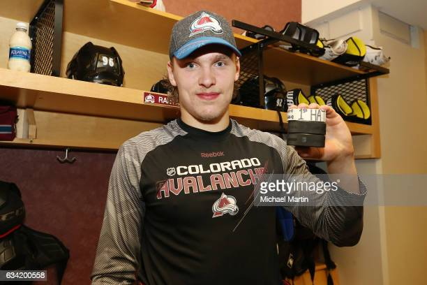 Mikko Rantanen of the Colorado Avalanche holds the three pucks from his first NHL hat trick against the Montreal Canadiens at the Pepsi Center on...