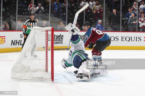 Mikko Rantanen of the Colorado Avalanche scores against goaltender Jacob Markstrom of the Vancouver Canucks during a shootout at the Pepsi Center on...