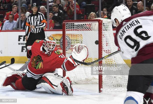 Mikko Rantanen of the Colorado Avalanche scores on goalie Anton Forsberg of the Chicago Blackhawks in the second period at the United Center on March...