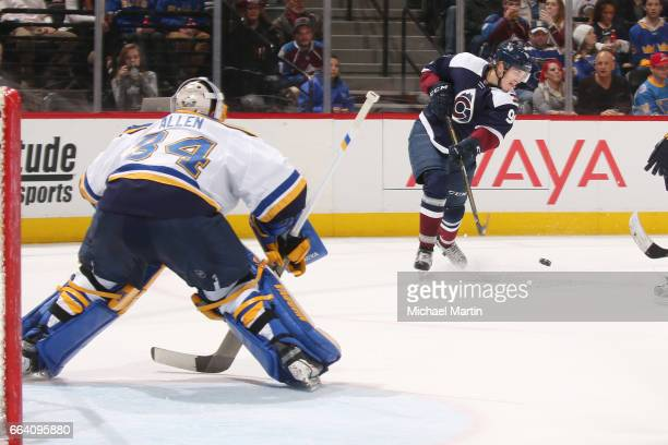 Mikko Rantanen of the Colorado Avalanche shoots against goaltender Jake Allen of the St Louis Blues at the Pepsi Center on March 31 2017 in Denver...