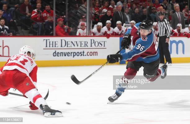 Mikko Rantanen of the Colorado Avalanche shoots against Luke Glendeningnof the Detroit Red Wings at the Pepsi Center on March 5 2019 in Denver...
