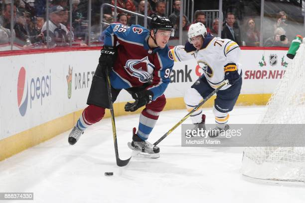 Mikko Rantanen of the Colorado Avalanche skates against Evan Rodrigues of the Buffalo Sabres at the Pepsi Center on December 5 2017 in Denver...