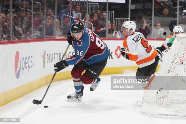 Mikko Rantanen of the Colorado Avalanche skates against Ivan Provorov of the Philadelphia Flyers at the Pepsi Center on March 28 2018 in Denver...