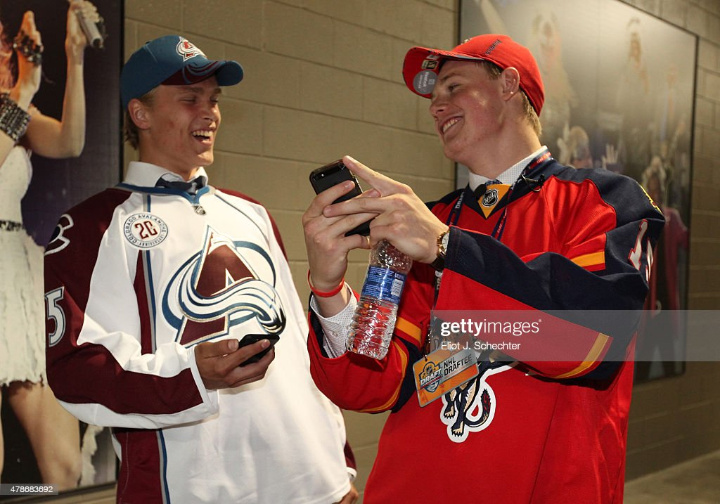 Mikko Rantanen (L), tenth overall selection by the Colorado Avalanche, and Lawson Crouse, 11th overall selection by the Florida Panthers, share a moment during Round One of the 2015 NHL Draft at BB&T Center on June 26, 2015 in Sunrise, Florida.