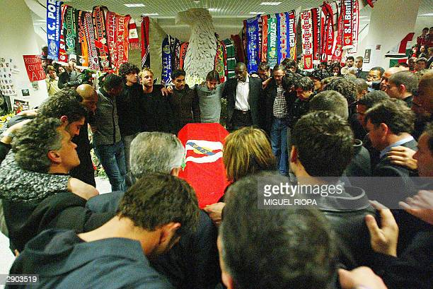 Miklos Feher Benfica's teammates embrace near the coffin with the body of the Hungarian player in the Luz Stadium at Lisbon 26 January 2004 who died...