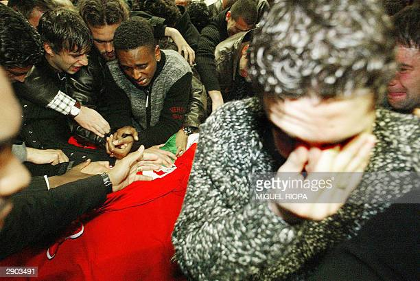 Miklos Feher Benfica's teammates Simao Roger Miguel and Moreira cry near the coffin with the body of the Hungarian player in the Luz Stadium at...