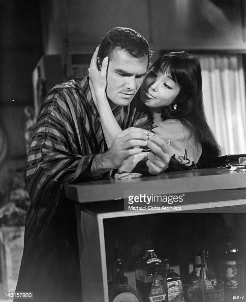 Miko Mayama making a seductive move toward Burt Reynolds in a scene from the film 'Impasse' 1969