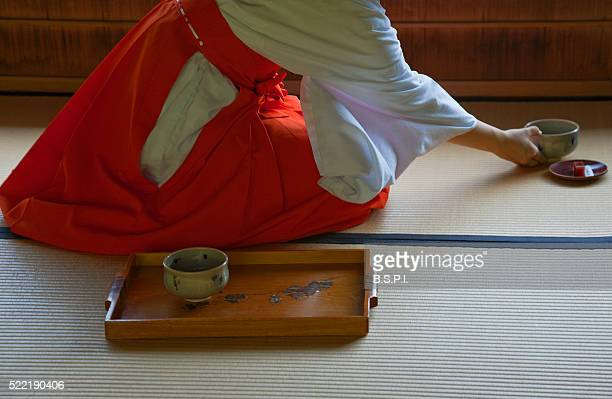 Miko Shrine Maiden Serves Green Tea at Jonan-gu Shrine in Kyoto, Japan