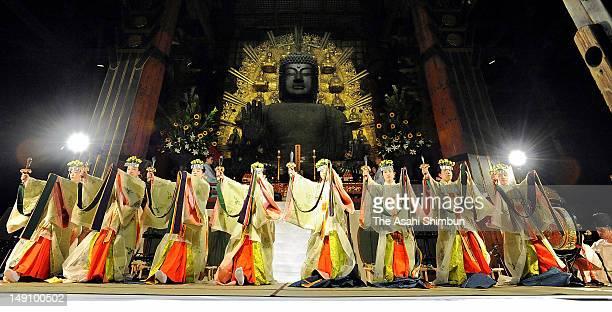 Miko shrine maidens of the Tsurugaoka Hachimangu dance at the hall of the Great Buddha of Nara to commemorate the earthquake and tsunami victims at...