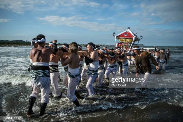 Mikoshi are carried in the sea by local villagers during the Ohara Hadaka Festival on September 23 2018 in Ohara Japan This festival is believed to...