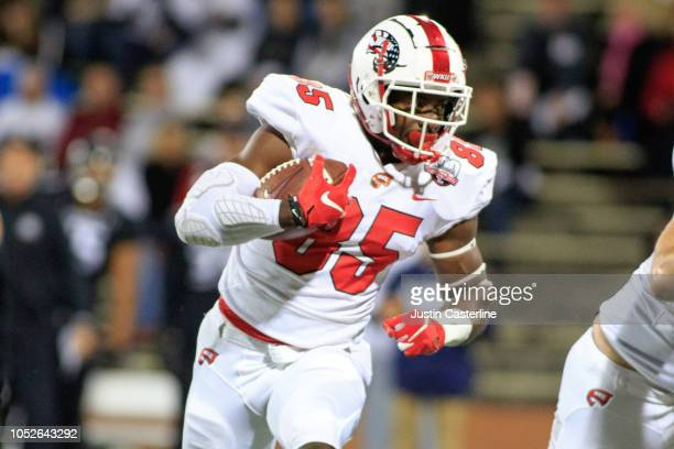 Mik'Quan Deane of the Western Kentucky Hilltoppers runs the ball in the game against the Old Dominion Monarchs on October 20 2018 in Bowling Green...
