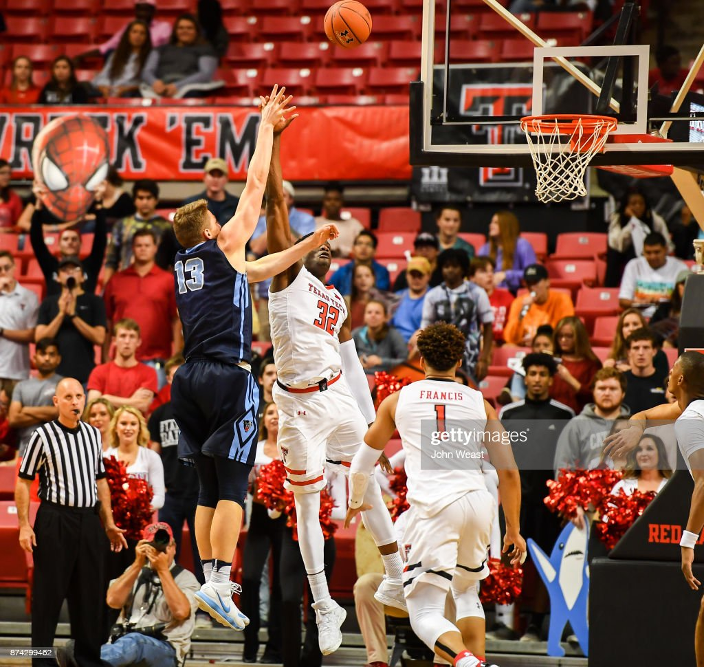 Miks Antoms #13 of the Maine Black Bears shoots the ball over Norense Odiase #32 of the Texas Tech Red Raiders during the game on November 14, 2017 at United Supermarkets Arena in Lubbock, Texas. Texas Tech defeated Maine 83-44.