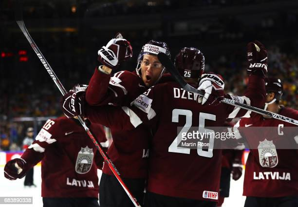 Miks Indrasis of Latvia celebrates a goal with team mates during the Germany v Latvia match of the 2017 IIHF Ice Hockey World Championships at...