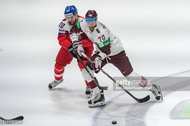Miks Indrasis of Latvia vies with Hynek Zohorna of Czech Republic during the 2019 IIHF Ice Hockey World Championship Slovakia group game between...