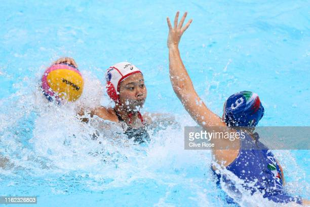 Miku Koide of Japan looks to pass against Giulia Emmolo of Italy during their Women's Water Polo Preliminary round match on day four of the Gwangju...