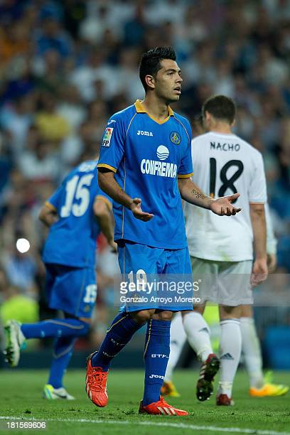 Miku of Getafe CF reacts defeated after his team failed to score during the La Liga match between Real Madrid CF and Getafe CF at Estadio Santiago...