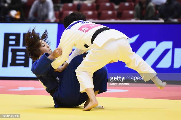 Miku Tashiro of Japan competes against Nami Nabekura of Japan in the Women's 63kg Final during day one of the Judo Grand Slam Tokyo at Tokyo...