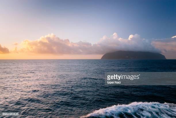 Mikurajima Island seen from the sea at sunrise, Tokyo