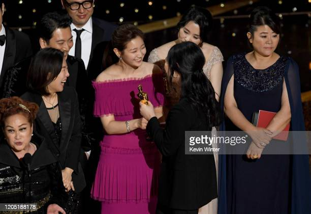 Miky Lee Kwak Sinae Sodam Park interpreter Sharon Choi and Hyejin Jang accept the Best Picture award for 'Parasite' onstage during the 92nd Annual...