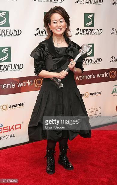 Miky Lee poses with her World Business Award in the media room backstage at the 3rd Annual Women's World Awards at Hammerstein Ballroom October 14...