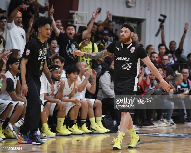 Miky Woodz of Team La Familia reacts after hitting a shot during Roc Nation's Roc da Court allstar basketball game benefiting the Boys Girls Clubs of...