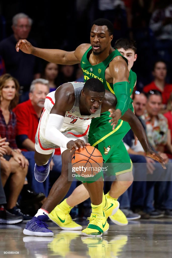 MiKyle McIntosh #22 of the Oregon Ducks fouls Rawle Alkins #1 of the Arizona Wildcats during the second half of the college basketball game at McKale Center on January 13, 2018 in Tucson, Arizona. The Wildcats beat the Ducks 90-83.