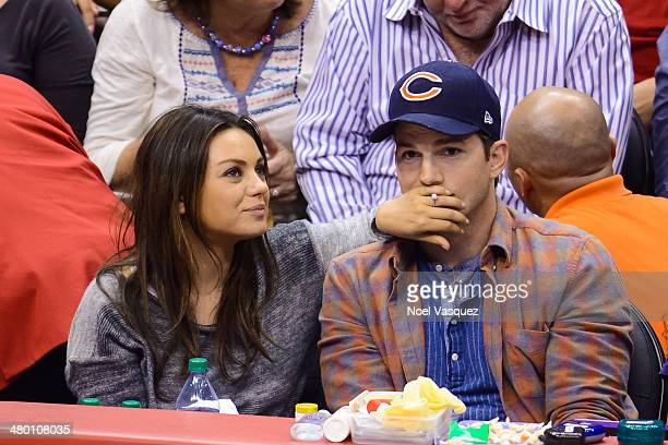 Mila Kunis and Ashton Kutcher attend a basketball between the Detroit Pistons and the Los Angeles Clippers at Staples Center on March 22, 2014 in Los...