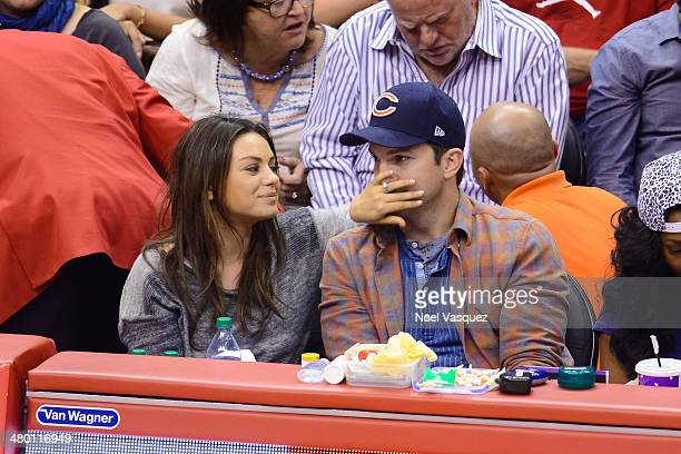 Mila Kunis and Ashton Kutcher attend a basketball between the Detroit Pistons and the Los Angeles Clippers at Staples Center on March 22 2014 in Los...