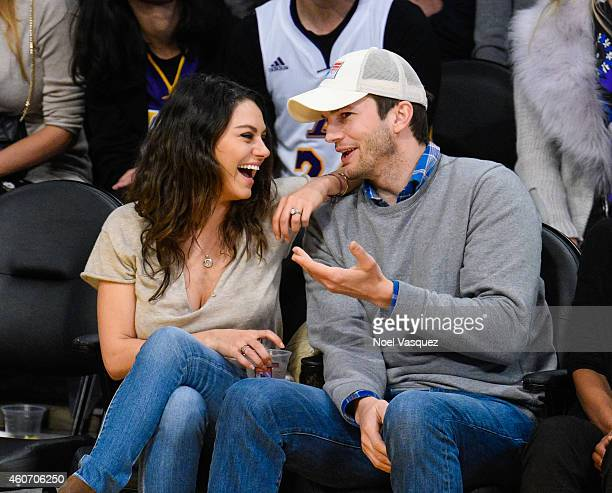 Mila Kunis and Ashton Kutcher attend a basketball game between the Oklahoma City Thunder and the Los Angeles Lakers at Staples Center on December 19,...