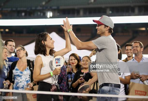 Mila Kunis and Ashton Kutcher play ping pong at Clayton Kershaw's 6th Annual Ping Pong 4 Purpose on August 23 2018 in Los Angeles California