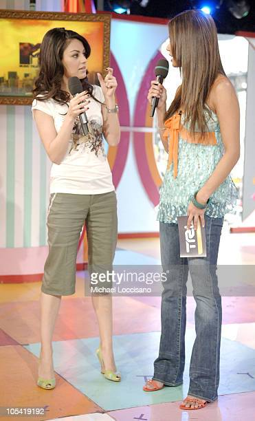 Mila Kunis and MTV VJ Vanessa Minnillo during Mila Kunis Visits MTV's 'TRL' April 25 2005 at MTV Studios Times Square in New York City New York...