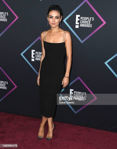 Mila Kunis arrives at the People's Choice Awards 2018 at Barker Hangar on November 11 2018 in Santa Monica California
