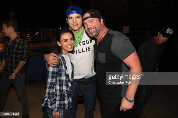 Mila Kunis Ashton Kutcher and Lee Brice pose during 2018 Stagecoach California's Country Music Festival at the Empire Polo Field on April 29 2018 in...