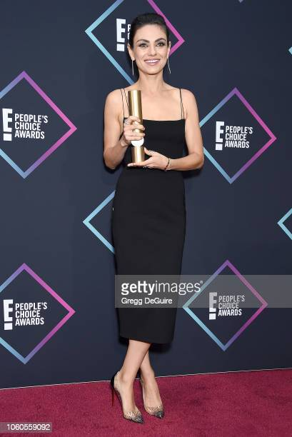 Mila Kunis Comedy Movie Star of 2018 poses in the press room at the People's Choice Awards 2018 at Barker Hangar on November 11 2018 in Santa Monica...