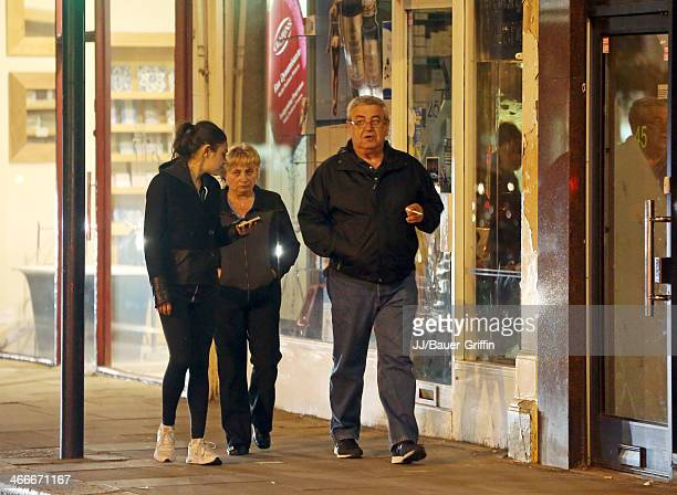 Mila Kunis with her parents Elvira Kunis and Mark Kunis are seen on May 20 2013 in London United Kingdom